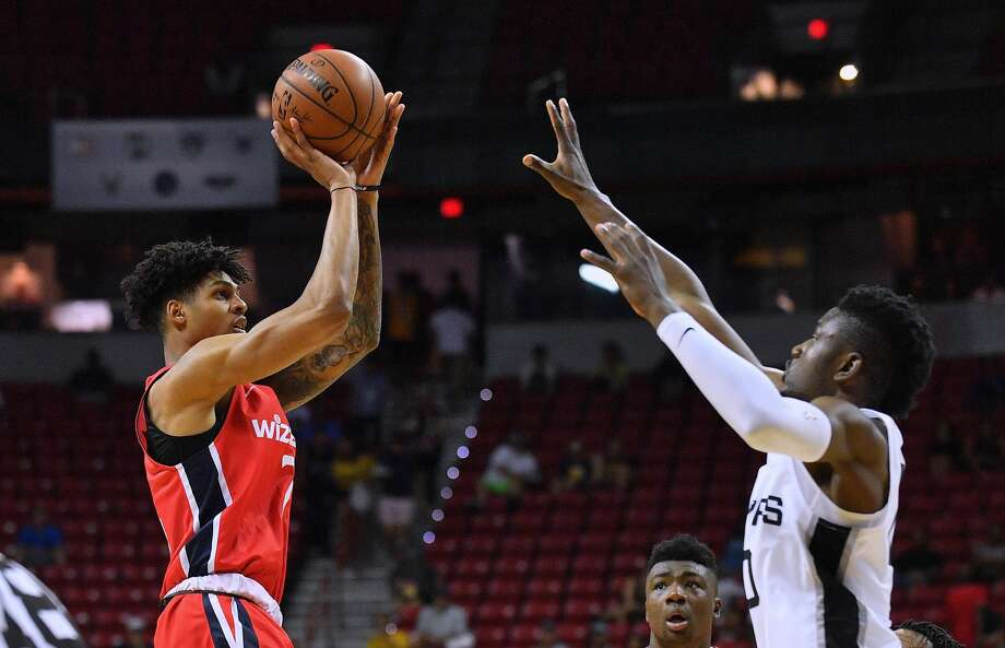 LAS VEGAS, NV - JULY 08:  Devin Robinson #7 of the Washington Wizards shoots against Chimezie Metu #10 of the San Antonio Spurs during the 2018 NBA Summer League at the Thomas & Mack Center on July 8, 2018 in Las Vegas, Nevada. NOTE TO USER: User expressly acknowledges and agrees that, by downloading and or using this photograph, User is consenting to the terms and conditions of the Getty Images License Agreement.  (Photo by Sam Wasson/Getty Images) Photo: Sam Wasson/Getty Images