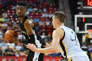 LAS VEGAS, NV - JULY 07:  Chimezie Metu #10 of the San Antonio Spurs posts up against TJ Leaf #22 of the Indiana Pacers during the 2018 NBA Summer League at the Thomas & Mack Center on July 7, 2018 in Las Vegas, Nevada. NOTE TO USER: User expressly acknowledges and agrees that, by downloading and or using this photograph, User is consenting to the terms and conditions of the Getty Images License Agreement.  (Photo by Sam Wasson/Getty Images)