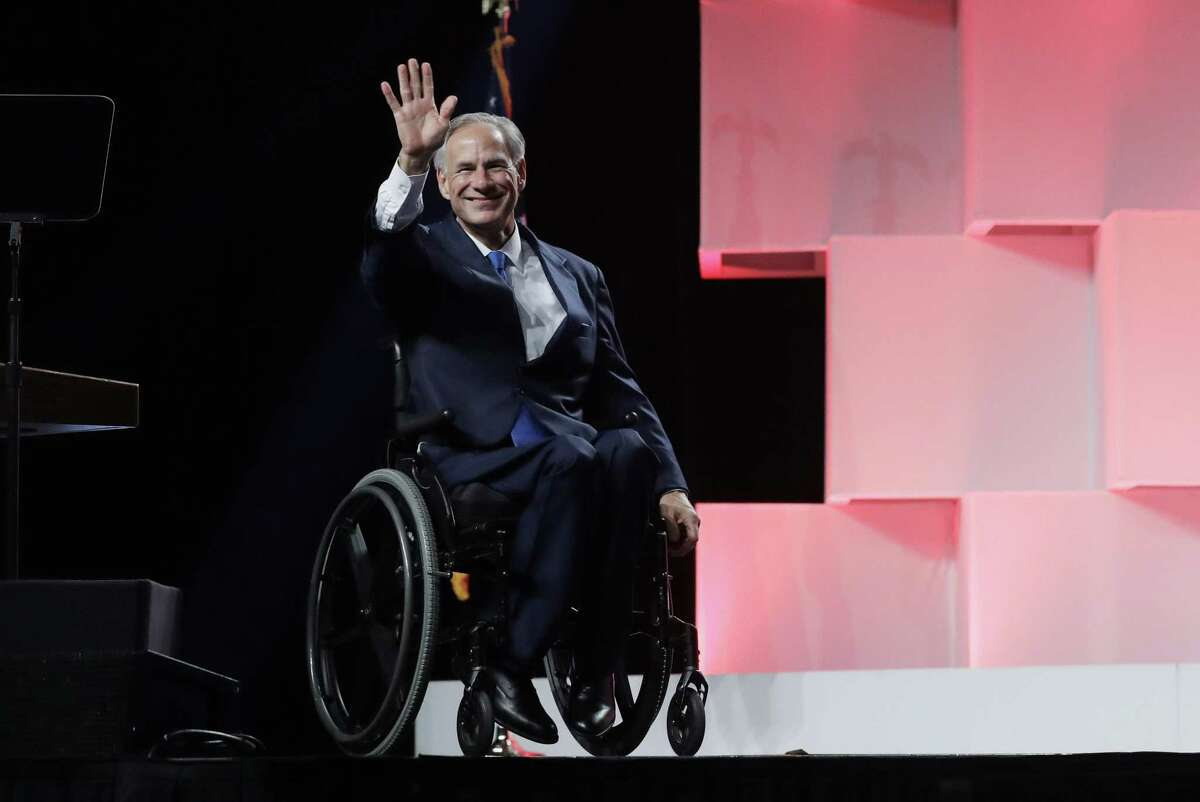 Texas Gov. Greg Abbott waves to delegates at the Texas GOP Convention, Friday, June 15, 2018, in San Antonio. (AP Photo/Eric Gay)