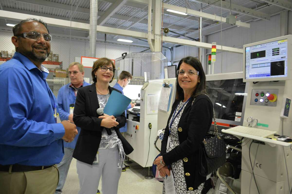 Fifth District Democratic Congressional Candidate Mary Glassman, right, at Altek Electronics Inc. in Torrington, is given a tour of the manufacturing floor by Ravi Kailan, director of operations and Sabrina Beck, vice president and co-owner.