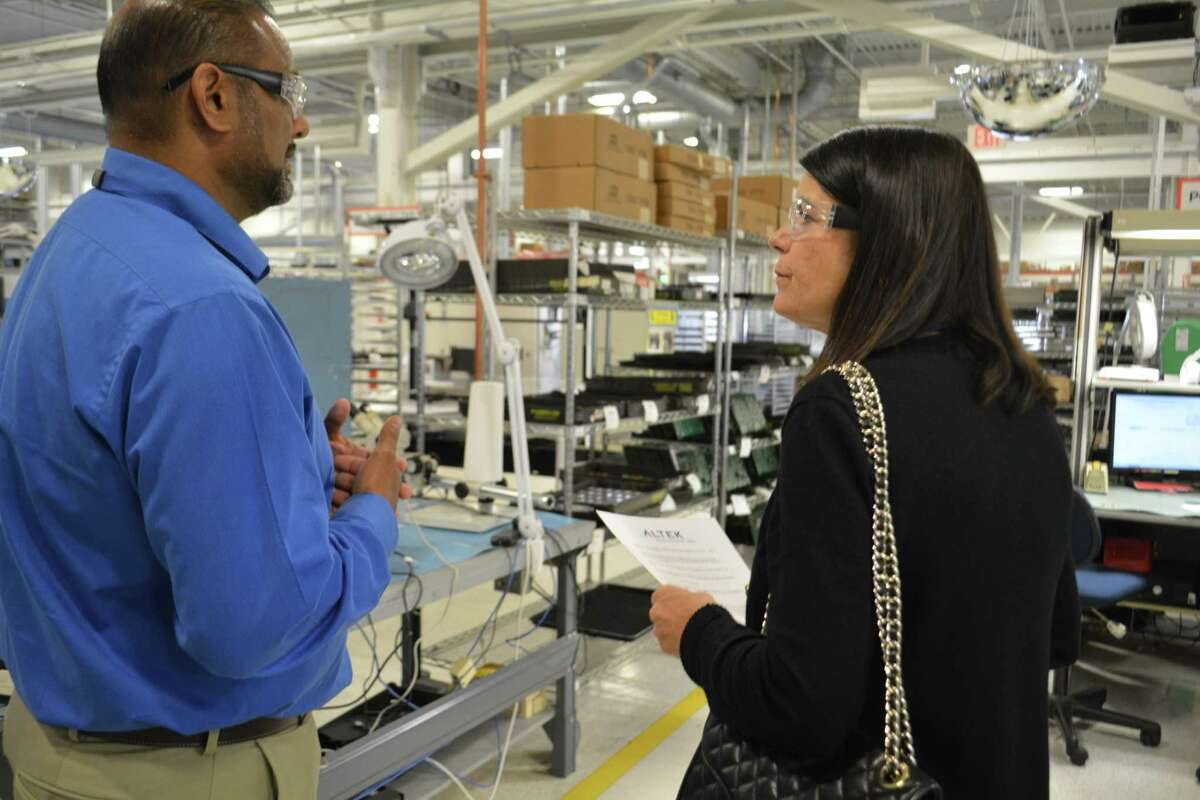 Fifth District Democratic Congressional candidate Mary Glassman is given a tour of Altek Electronics Inc. in Torrington by Ravi Kailan, director of operations.
