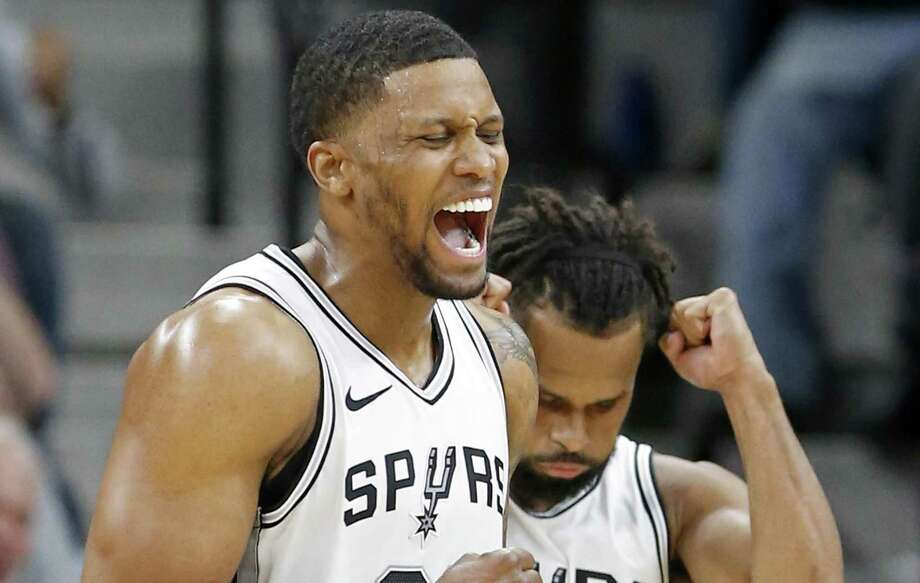 San Antonio Spurs forward Rudy Gay (22) and guard Patty Mills (8) celebrate after forward Kyle Anderson (1), not pictured, was fouled by Sacramento Kings center Willie Cauley-Stein (00), not pictured, during second half action Monday April 9, 2018 at the AT&T Center. The Spurs won 98-85. Photo: Edward A. Ornelas, Staff / San Antonio Express-News / © 2018 San Antonio Express-News