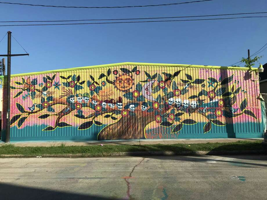 Morales Funeral Home commissioned Angel Quesada to create the life and death-inspired mural on a facade of Morales Radio Hall at 111 N. Ennis. Photo: Courtesy Of The Artist / Courtesy Of The Artist