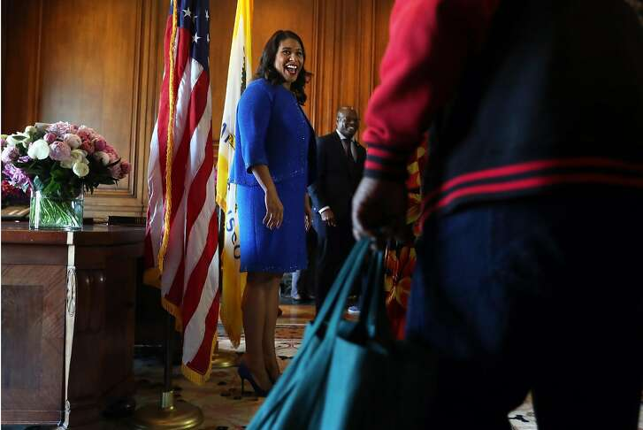 San Francisco Mayor London Breed greets a member of the public in the receiving line after Breed's inauguration at City Hall in San Francisco, Calif. on Wednesday, July 11, 2018.