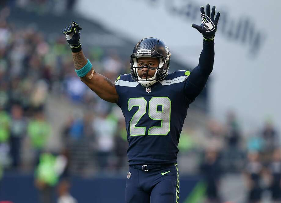 Seattle Seahawks free safety Earl Thomas (29) celebrates after cornerback Richard Sherman's (25) interception against the Houston Texans during the second half of the game at CenturyLink Field Sunday, Oct. 29, 2017, in Seattle. The Seahawks won 41-38. ( Godofredo A. Vasquez / Houston Chronicle ) Photo: Godofredo A. Vasquez, Houston Chronicle