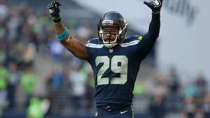 Seattle Seahawks free safety Earl Thomas (29) celebrates after cornerback Richard Sherman's (25) interception against the Houston Texans during the second half of the game at CenturyLink Field Sunday, Oct. 29, 2017, in Seattle. The Seahawks won 41-38. ( Godofredo A. Vasquez / Houston Chronicle )