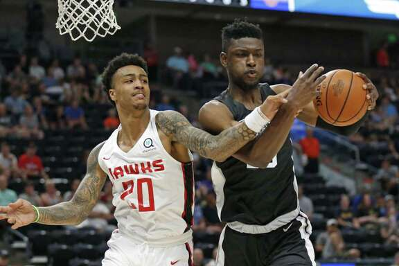 Spurs rookie Chimezie Metu (right) suffered a left wrist fracture July 8 against the Wizards. It was initially diagnosed as a sprain.