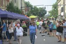 Main Street Marketplace, Torrington's annual street fair, began Wednesday night. By 5:30 p.m., a few hundred people were perusing booths, enjoying dinner from participating food trucks and taking train rides downtown. Future dates for the fair include July 18, 25 and Aug. 1.