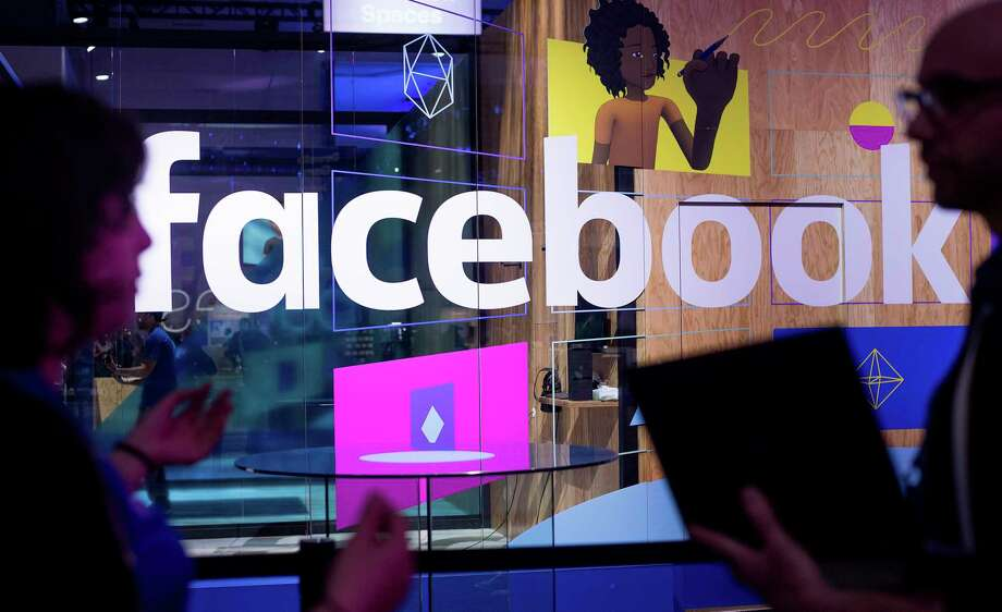 FILE - In this Tuesday, April 18, 2017, file photo, conference workers speak in front of a demo booth at Facebook's annual F8 developer conference, in San Jose, Calif. The chairman of the U.K. Parliament's media committee says the government office that investigated the Cambridge Analytica scandal has fined Facebook 500,000 pounds ($663,000) for failing to safeguard users' data. (AP Photo/Noah Berger, File) Photo: Noah Berger / Noah Berger