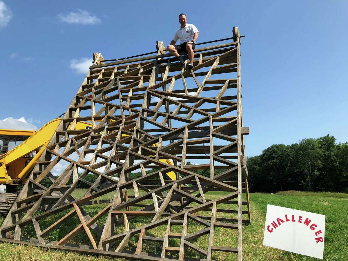 """Craig Boyarsky, a senior fitness director at Best Fitness, scales the Challenger obstacle at Maple Ski Ridge, which is hosting its annual """"Run the Ridge"""" 5K mud, trail and obstacle course on Saturday. (Jennifer Patterson / Times Union)"""