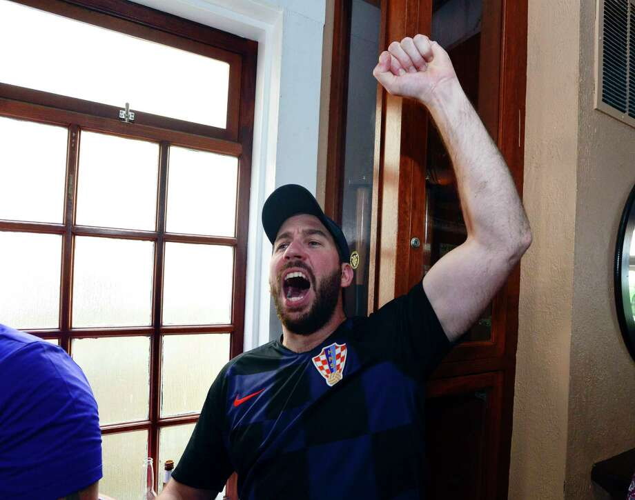 Rob Vebegonja of Stamford celebrates as he waits for a group of Croatia fans to arrive at Casey's Tavern in Stamford, Connecticut on July 11, 2018. Vebegonja braved the crowd of English soccer fans gathered to watch the semi final match between England and Croatia in the 2018 Fifa World Cup. Croatia won 2-1 advancing to Sunday's final against France. Photo: Matthew Brown, Hearst Connecticut Media / Stamford Advocate