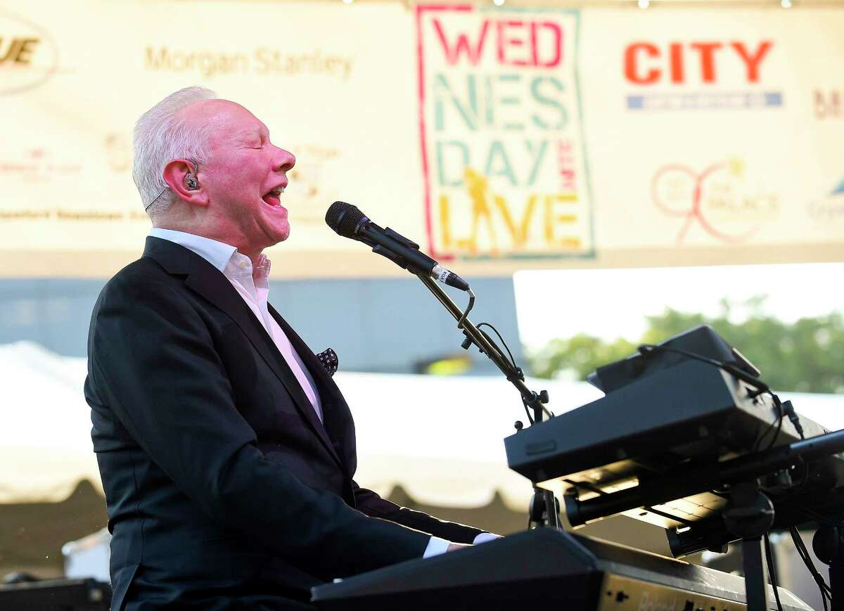 Legendary songwriter Joe Jackson entertains the audience gathered in Columbus Park for the Wednesday Night Live concert series on July 11, 2018 in Stamford, Connecticut.