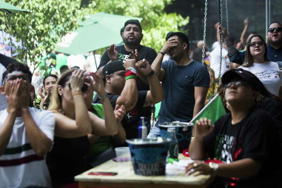 Mexico fans react toward the inability of their soccer team to break down Brazil's defense during a World Cup match on July 2, 2018. The fans gathered to watch the game at Pitch 25 in Houston. Photo: Marie D. De Jesús, Staff / Houston Chronicle / © 2018 Houston Chronicle