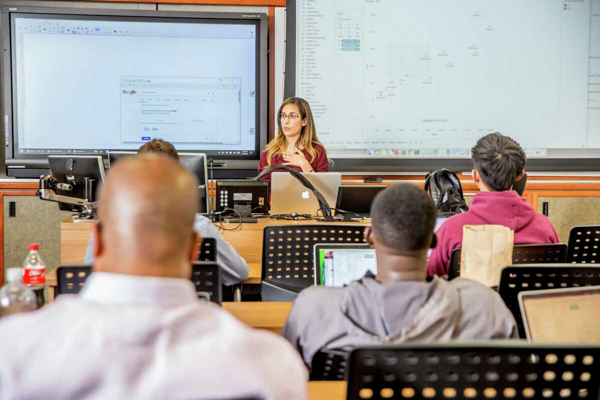 A professor teaches at a University of Southern California data analytics boot camp hosted in partnership with Trilogy Education. Trilogy is teaming up with Rice University to launch a data analytics boot camp this fall.