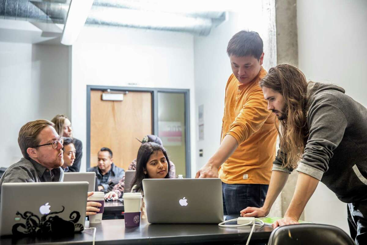Students learn at a University of California, Los Angeles boot camp hosted in partnership with Trilogy Education. Trilogy is teaming up with Rice University to launch boot camp programs.