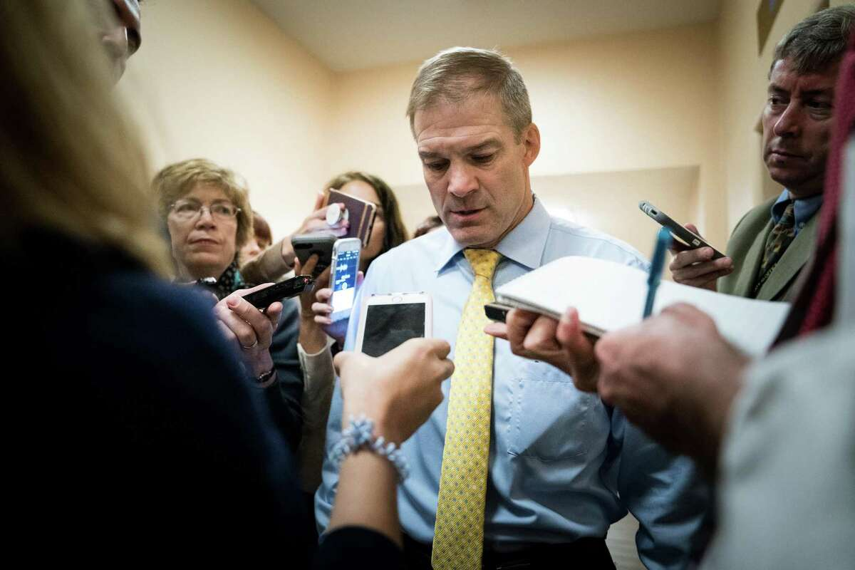FILE -- Rep. Jim Jordan (R-Ohio) is questioned by reporters in a Capitol Hill hallway, in Washington, June 26, 2018. Jordan is facing a slowly-percolating sexual misconduct scandal, as new accusers step forward by the day to say the wrestling coach-turned-politician was aware of allegations that an Ohio State University doctor fondled multiple students, but did nothing to stop it. (Erin Schaff/The New York Times)