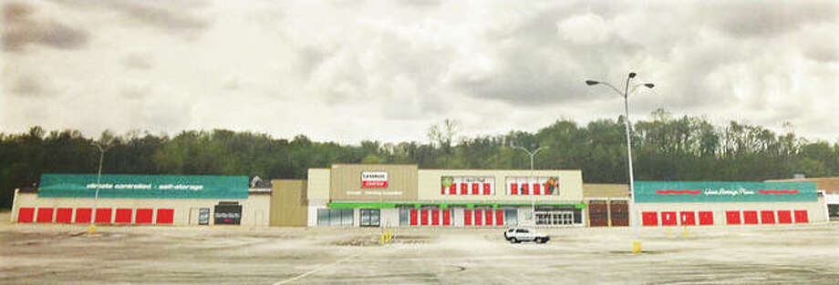 Photo shows exterior improvements to a former Kmart building that will become a U-Haul Moving and Storage Center in Alton, Ill. A Queensbury Kmart is among 13 nationwide that are being purchased by U-Haul. Photo:       Linda N. Weller | The Telegraph