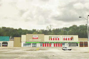 Exterior improvements to the former Kmart building that will house the multi-faceted, U-Haul Moving and Storage Center in the 1800 block of Homer Adams Parkway in Alton.
