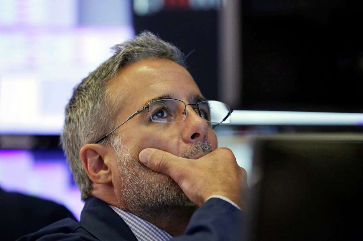 Specialist Anthony Rinaldi works on the floor of the New York Stock Exchange, Wednesday, July 11, 2018. Stocks are opening lower on Wall Street, following declines in Europe and Asia, after Washington threatened to expand tariffs on Beijing and China said it would retaliate. (AP Photo/Richard Drew)