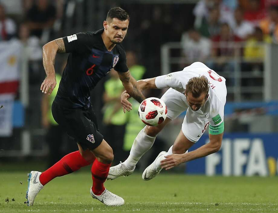 "Croatia's Dejan Lovren (left, battling England's Harry Kane in Wednesday's semifinal) said ""Maybe it's our time to revenge something"" against France, which beat Croatia in the '98 semis. Photo: Alastair Grant / Associated Press"