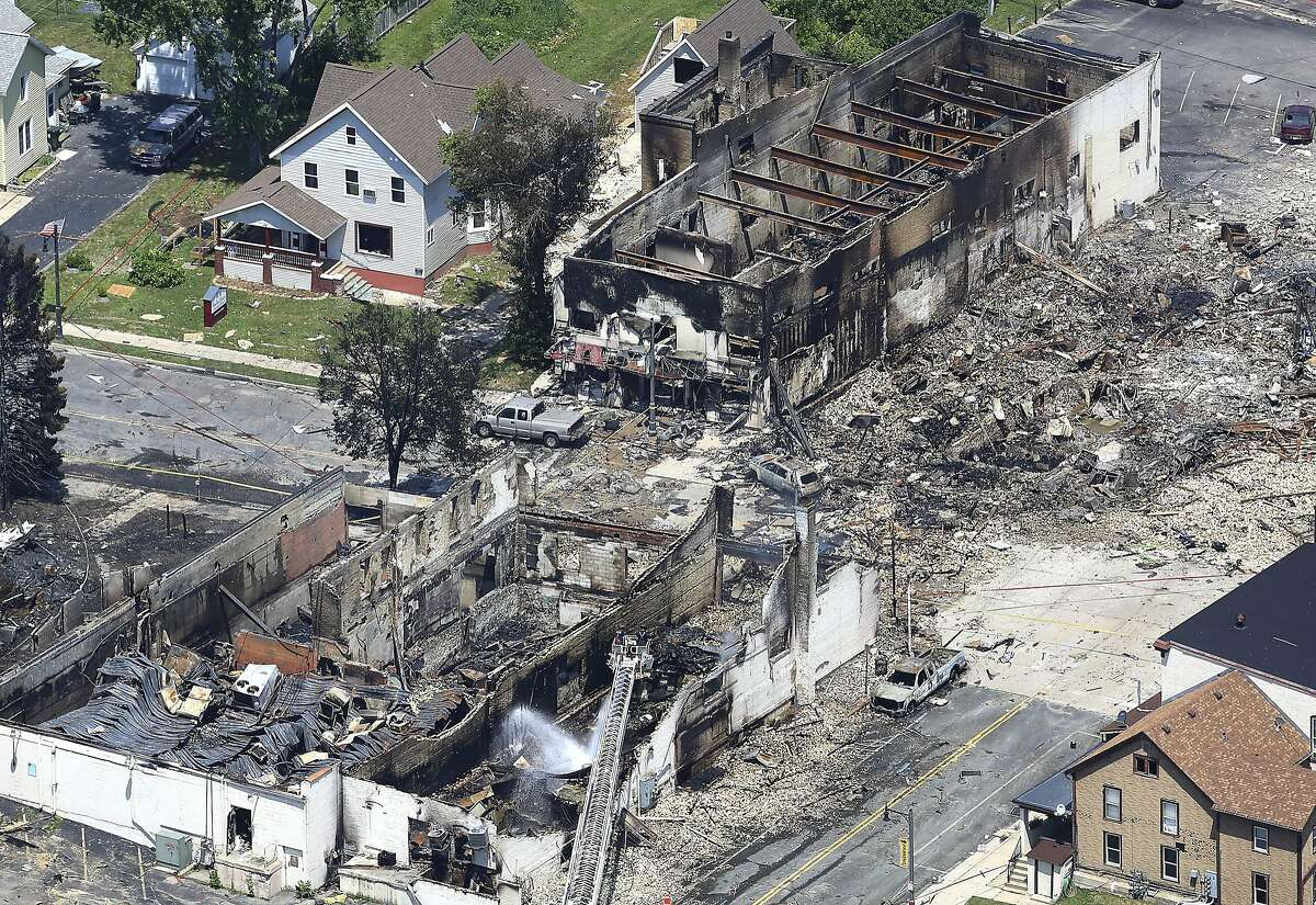 July 2018 Sun Prairie, Wis. In a view looking northwest from above, the aftermath of a gas explosion in downtown Sun Prairie, Wis., is seen Wednesday, July 11, 2018. At the top right of the image is the site of the former Barr House where the explosion originated and leveled the building. Sun Prairie Fire Department Capt. Cory Barr was killed Tuesday when a natural gas explosion leveled most of a city block, including the tavern Barr owned.