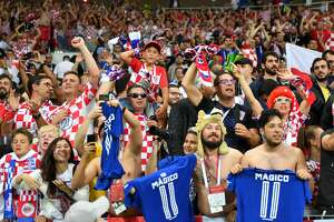 Croatia fans celebrate at the end of the Russia 2018 World Cup semi-final football match between Croatia and England at the Luzhniki Stadium in Moscow on July 11, 2018.
