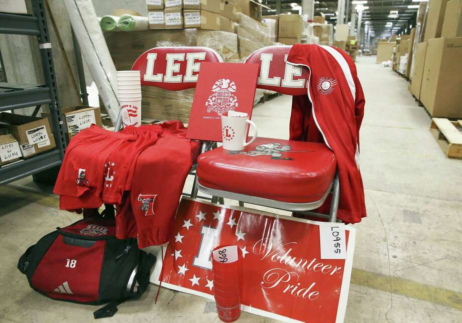 Auction numbers decorate a display as North East ISD employees sort through Lee-branded items from Robert E. Lee High School on July 11, 2018. Photo: Tom Reel, Staff / San Antonio Express-News / 2017 SAN ANTONIO EXPRESS-NEWS