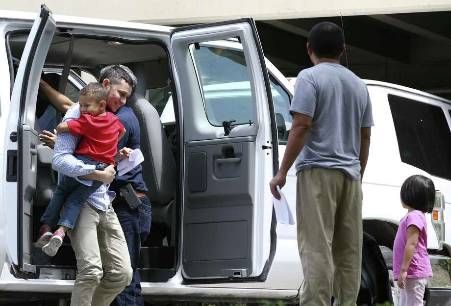 Immigrant families arrive at the Archdiocese of San Antonio Catholic Charities offices in San Antonio, Wednesday, July 11, 2018. Earlier the families left a U.S. Immigration and Customs Enforcement facility after they were reunited overnight. Photo: JERRY LARA / San Antonio Express-News / San Antonio Express-News