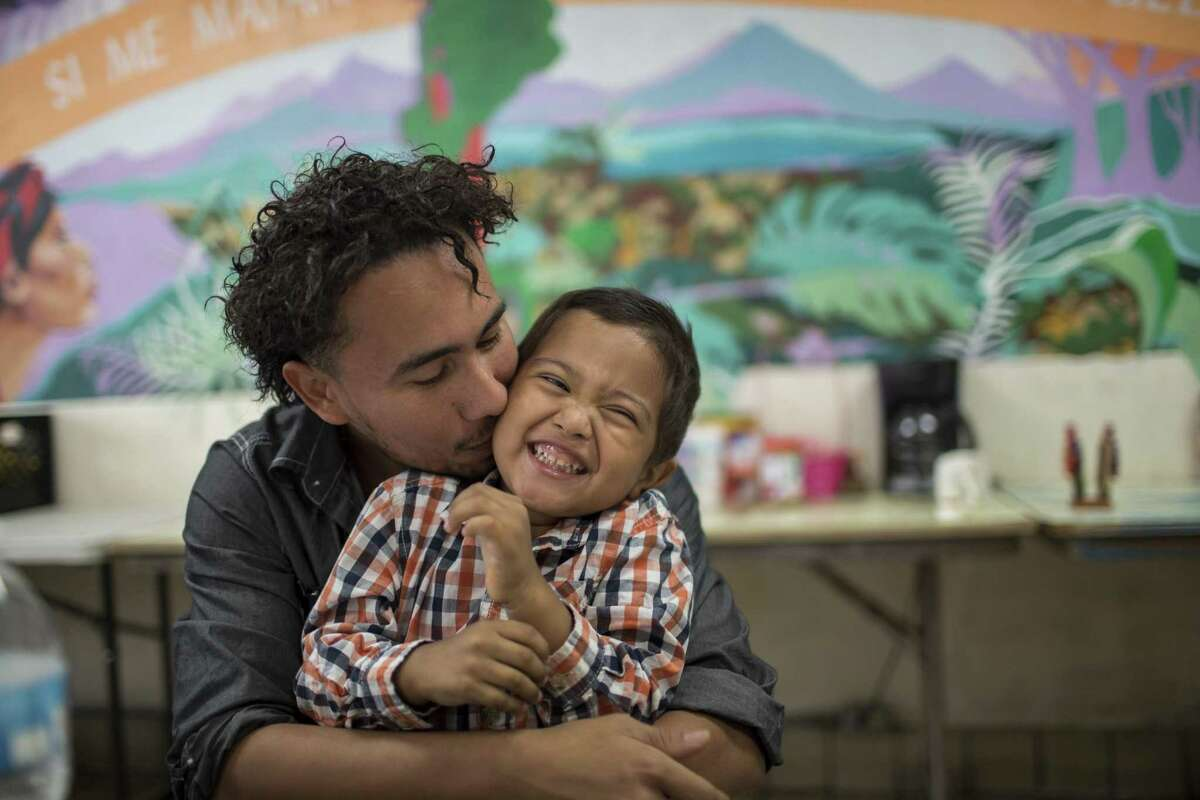 Roger and his 4-year-old son Roger Jr, (only first names given) embrace before a press conference at the Annunciation House, Wednesday, July 11, 2018, in El Paso, Texas. After being separated by CBP in February, the two were reunited and released by ICE late last night. Photo by Ivan Pierre Aguirre