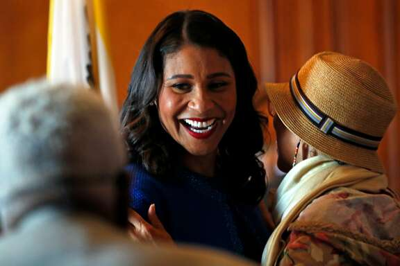 San Francisco Mayor London Breed greets members of the public in the receiving line after Breed's inauguration at City Hall in San Francisco, Calif. on Wednesday, July 11, 2018.