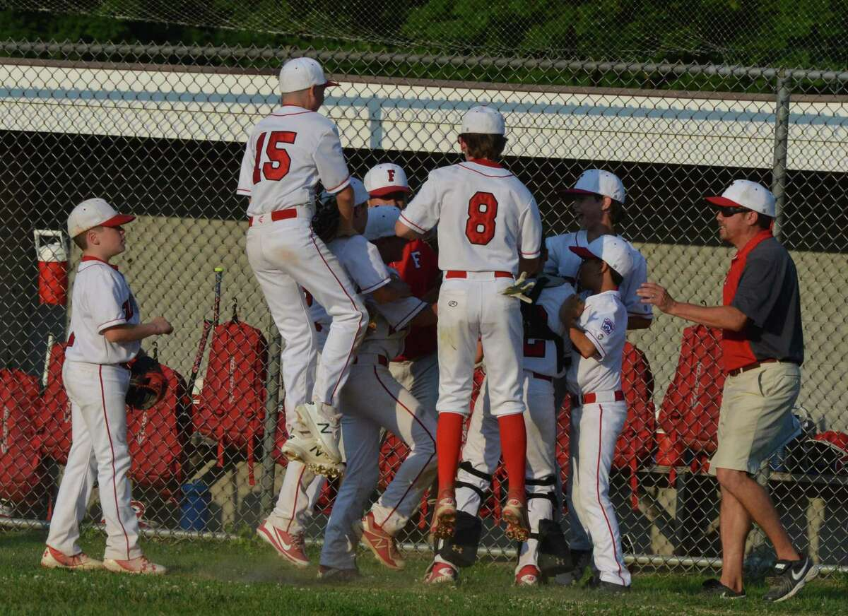 Fairfield American celebrates the win over Trumbull National in Little League action on Wednesday july 11, 2018 in Trumbull Conn.