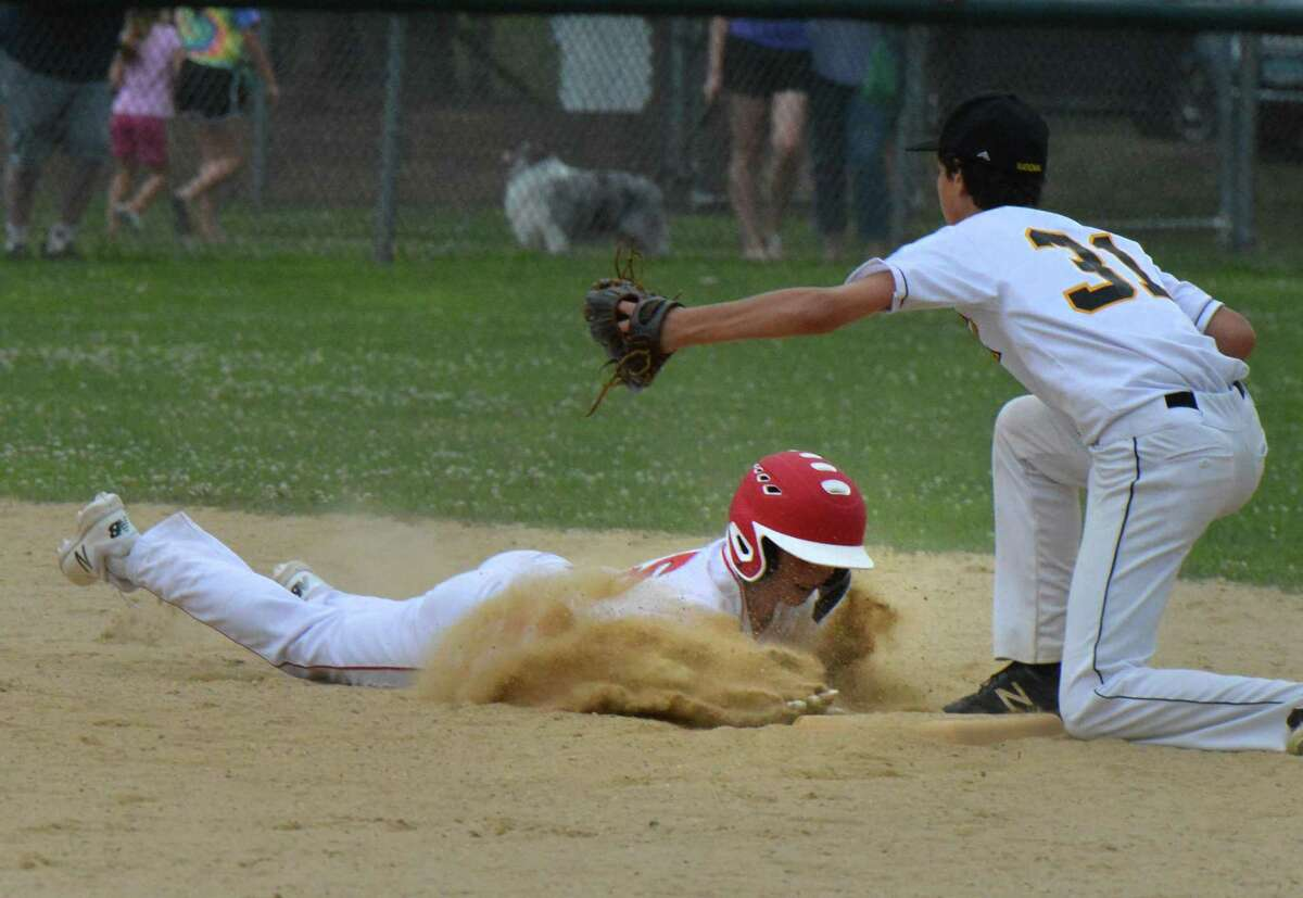 Fairfield American's #15 Jon Morris makes it back to second base vs. Trumbull National in Little League action on Wednesday july 11, 2018 in Trumbull Conn.