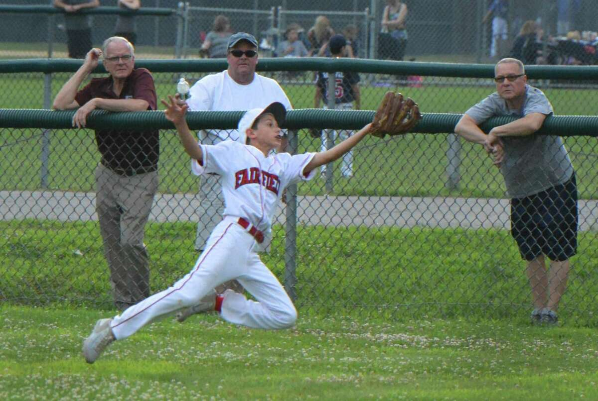 Fairfield American's #4 Eli Balkan makes the diving catch for the out vs. Trumbull National in Little League action on Wednesday july 11, 2018 in Trumbull Conn.