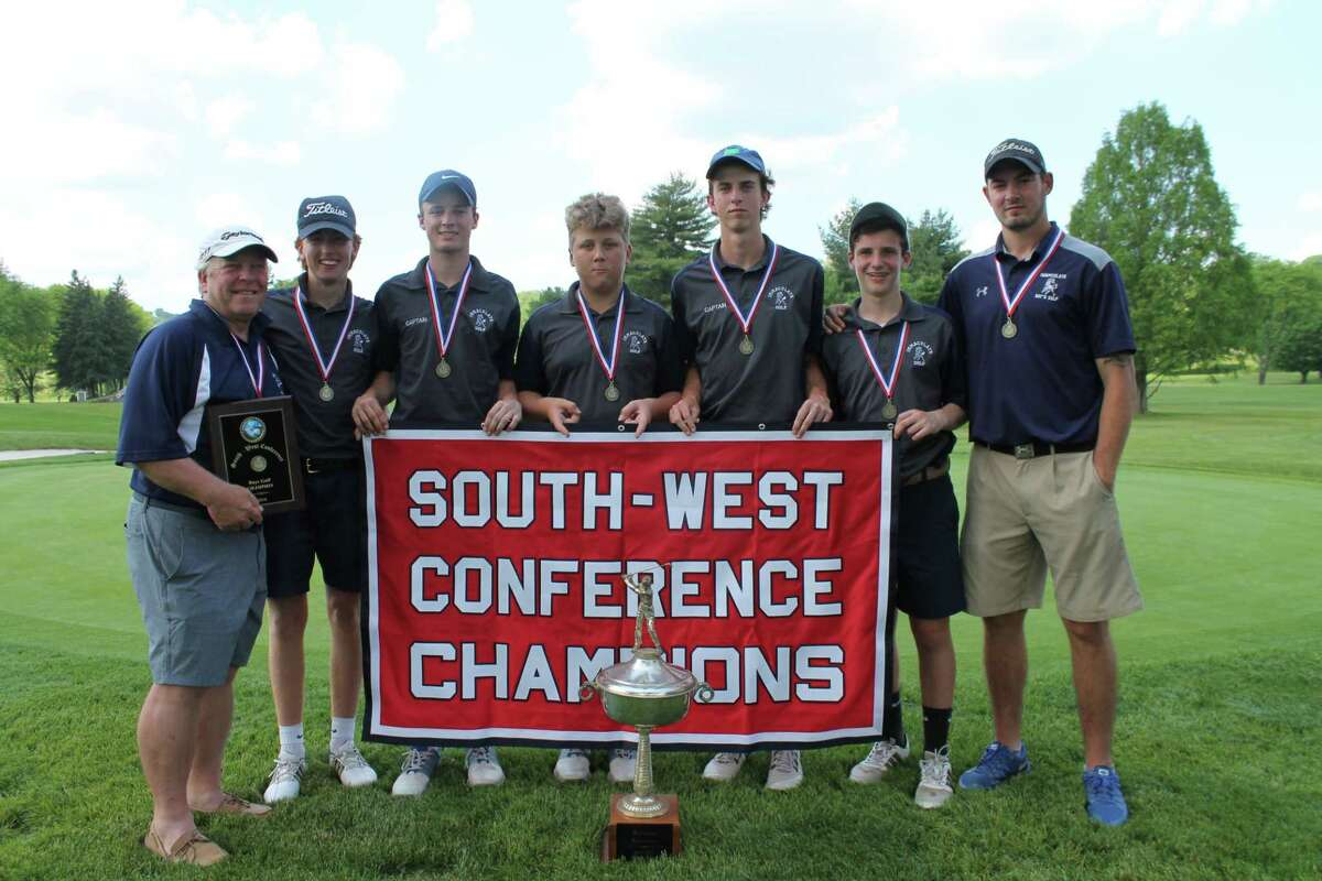 The Immaculate High School boys golf team with its South-West Conference championship banner.