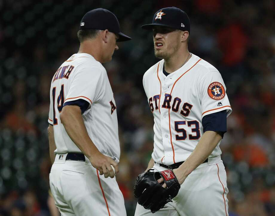 Ken Giles, right, reacts as he hands the ball to Astros manager A.J. Hinch as he exited Tuesday's game against Oakland at Minute Maid Park during the ninth inning. Giles, who had been the team's closer, was optioned to Class AAA Fresno on Wednesday. Photo: Karen Warren, Staff / Houston Chronicle / © 2018 Houston Chronicle