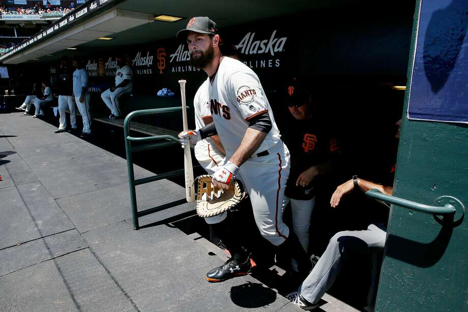 San Francisco Giants first baseman Brandon Belt (9) makes his way to the field with his baseball gear before an MLB game between the San Francisco Giants and Chicago Cubs at AT&T Park, Wednesday, July 11, 2018, in San Francisco, Calif. Photo: Santiago Mejia / The Chronicle