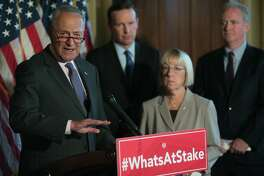 Senate Minority Leader Chuck Schumer (D-N.Y.) speaks at a news conference where he and fellow Democrats criticized Judge Brett Kavanaugh, on Capitol Hill in Washington, July 11, 2018. From left: Sens. Schumer; Patty Murray (D-Wash.); Chris Murphy (D-Conn.)' and Chris Van Hollen (D-Md.). (Lawrence Jackson/The New York Times)