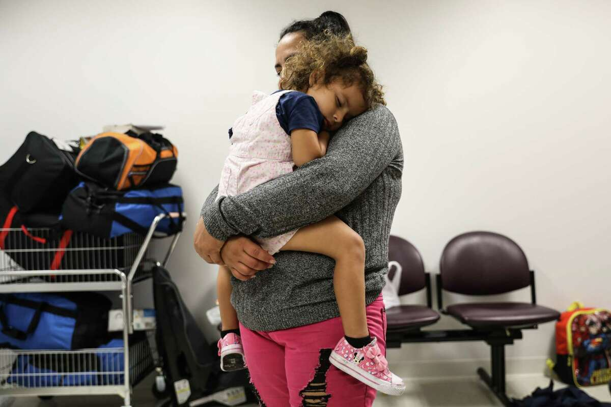 Celia Del Carmen Delgado, an immigrant from El Salvador, and her 3-year-old daughter, Adela, are reunited at Federal Plaza in Manhattan, July 11, 2018. Delgado said, she was told by immigration authorities that deportation was the only way she would get her daughter back. At first she had agreed, she said, but when she learned she would be deported alone, she said, she resisted. A trickle of families separated at the border were reunited Wednesday in New York, a day after a court deadline, while thousands remained apart. (Marian Carrasquero/The New York Times)