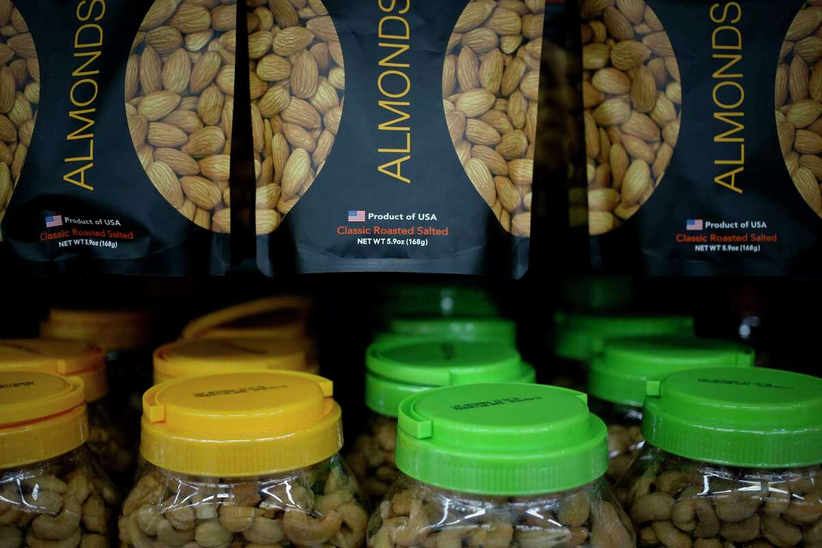 """Imported nuts from the United States are displayed for sale at a hypermarket in Beijing, Wednesday, July 11, 2018. China's government has criticized the latest U.S. threat of a tariff hike as """"totally unacceptable"""" and vowed to retaliate in their escalating trade war. The Commerce Ministry on Wednesday gave no details, but Beijing responded to last week's U.S. tariff hike on $34 billion of imports from China by increasing its own duties on the same amount of American goods. (AP Photo/Andy Wong)"""