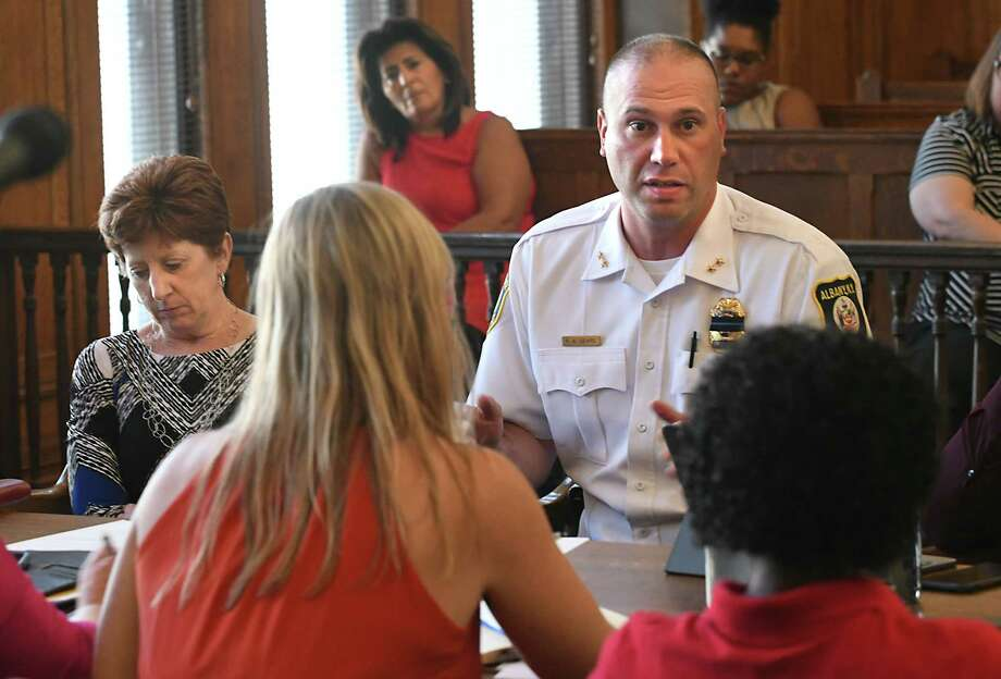 Albany Mayor Kathy Sheehan, left, and Albany's Acting Police Chief Robert Sears, right, speak about the uptick in violence during a common council caucus at City Hall on Wednesday, July 11, 2018 in Albany, N.Y. The city saw its eighth homicide this year early Saturday morning with the death of Kahlil Barnes, 31. (Lori Van Buren/Times Union) Photo: Lori Van Buren