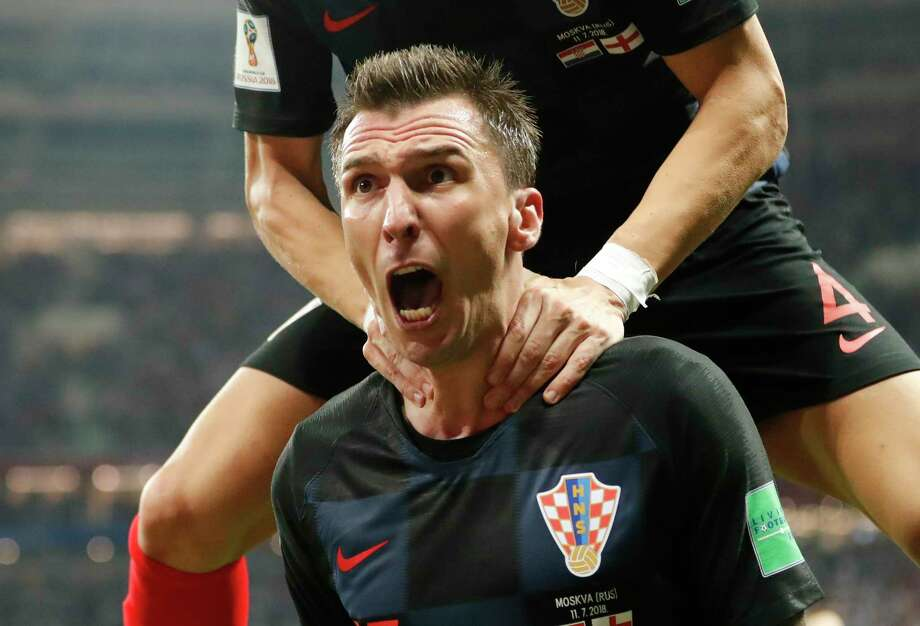 Croatia's Mario Mandzukic celebrates after scoring his side's second goal during the semifinal match between Croatia and England at the 2018 soccer World Cup in the Luzhniki Stadium in Moscow, Russia, Wednesday, July 11, 2018. (AP Photo/Frank Augstein) Photo: Frank Augstein / Copyright 2018 The Associated Press. All rights reserved
