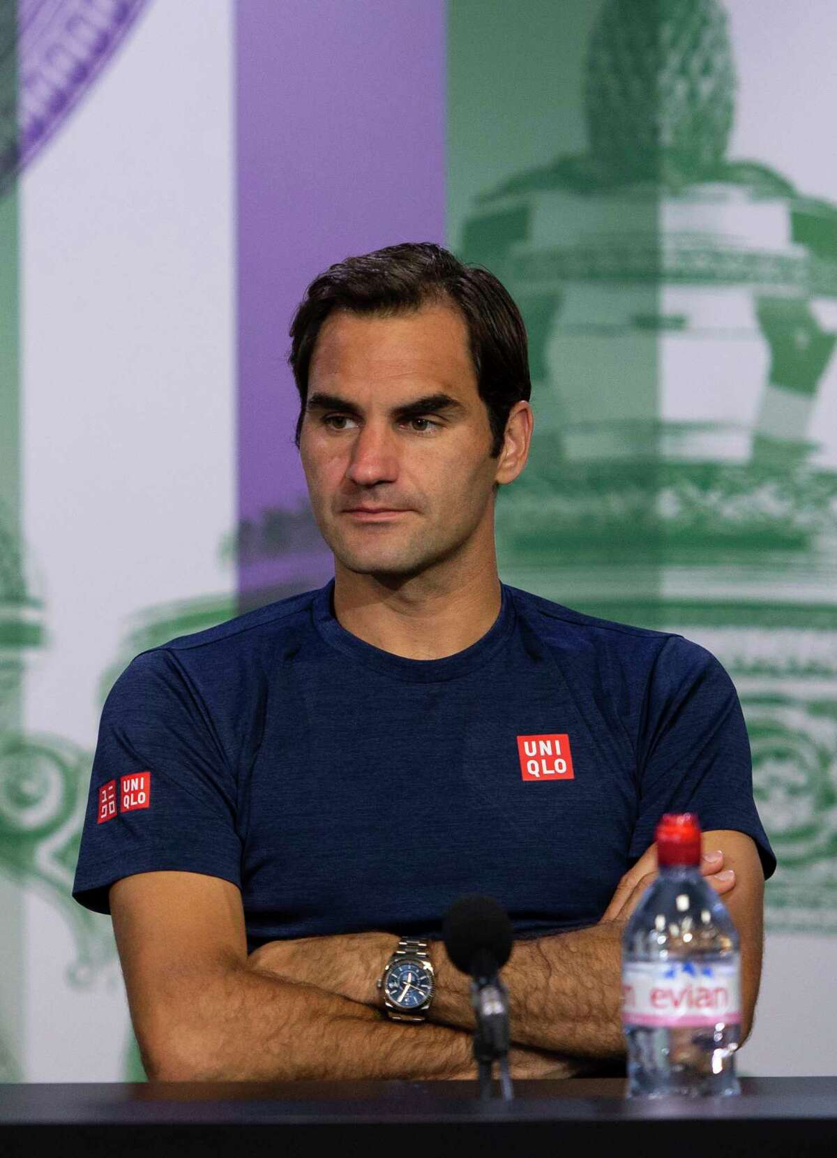 Roger Federer of Switzerland speaks during a press conference after being defeated by Kevin Anderson of South Africa in their men's singles quarterfinal match at the Wimbledon Tennis Championships in London, Wednesday July 11, 2018. (Florian Eisele/AELTC via AP)