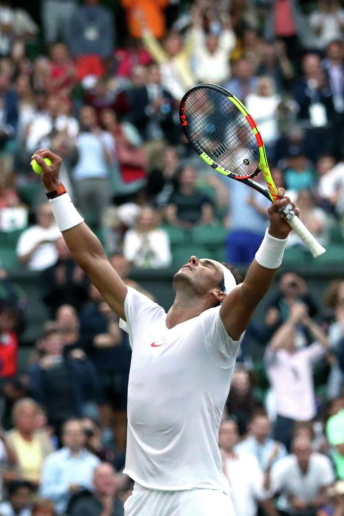 LONDON, ENGLAND - JULY 11: Rafael Nadal of Spain celebrates winning match point against Juan Martin Del Potro of Argentina during their Men's Singles Quarter-Finals match on day nine of the Wimbledon Lawn Tennis Championships at All England Lawn Tennis and Croquet Club on July 11, 2018 in London, England. Nadal won the match 5-7, 7-6, 6-4, 4-6, 4-6 in 4hr 47min. (Photo by Clive Brunskill/Getty Images)