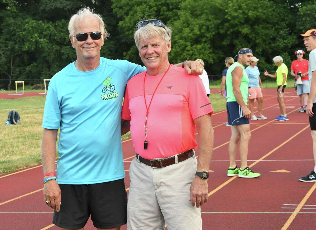 Founders Frank Myers, left, and his brother Donnie Myers are seen on the track during the weekly summer track meet at Colonie High School on Tuesday, July 10, 2018 in Colonie, N.Y. (Lori Van Buren/Times Union)