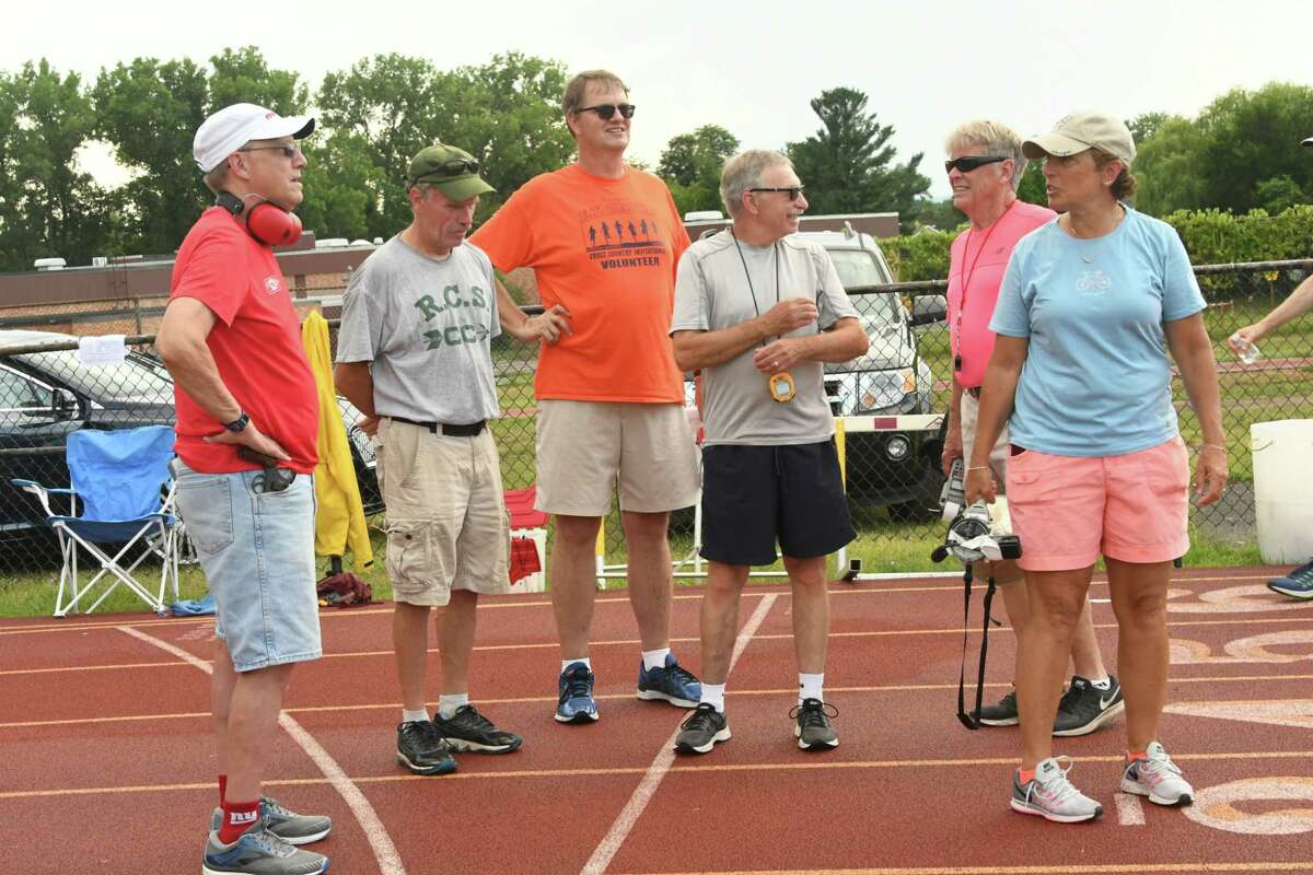 Timers and starters are seen on the track during the weekly summer track meet at Colonie High School on Tuesday, July 10, 2018 in Colonie, N.Y. (Lori Van Buren/Times Union)