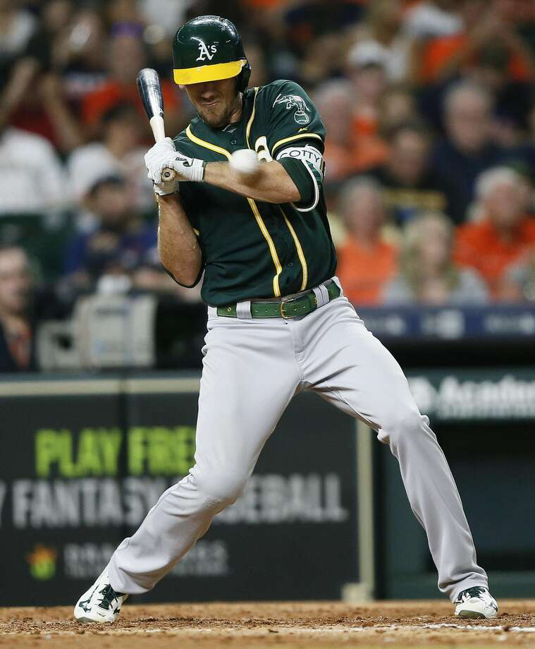 Stephen Piscotty #25 of the Oakland Athletics is hit by a pitch in the fifth inning against the Oakland Athletics at Minute Maid Park on July 11, 2018 in Houston, Texas. Photo: Bob Levey / Getty Images