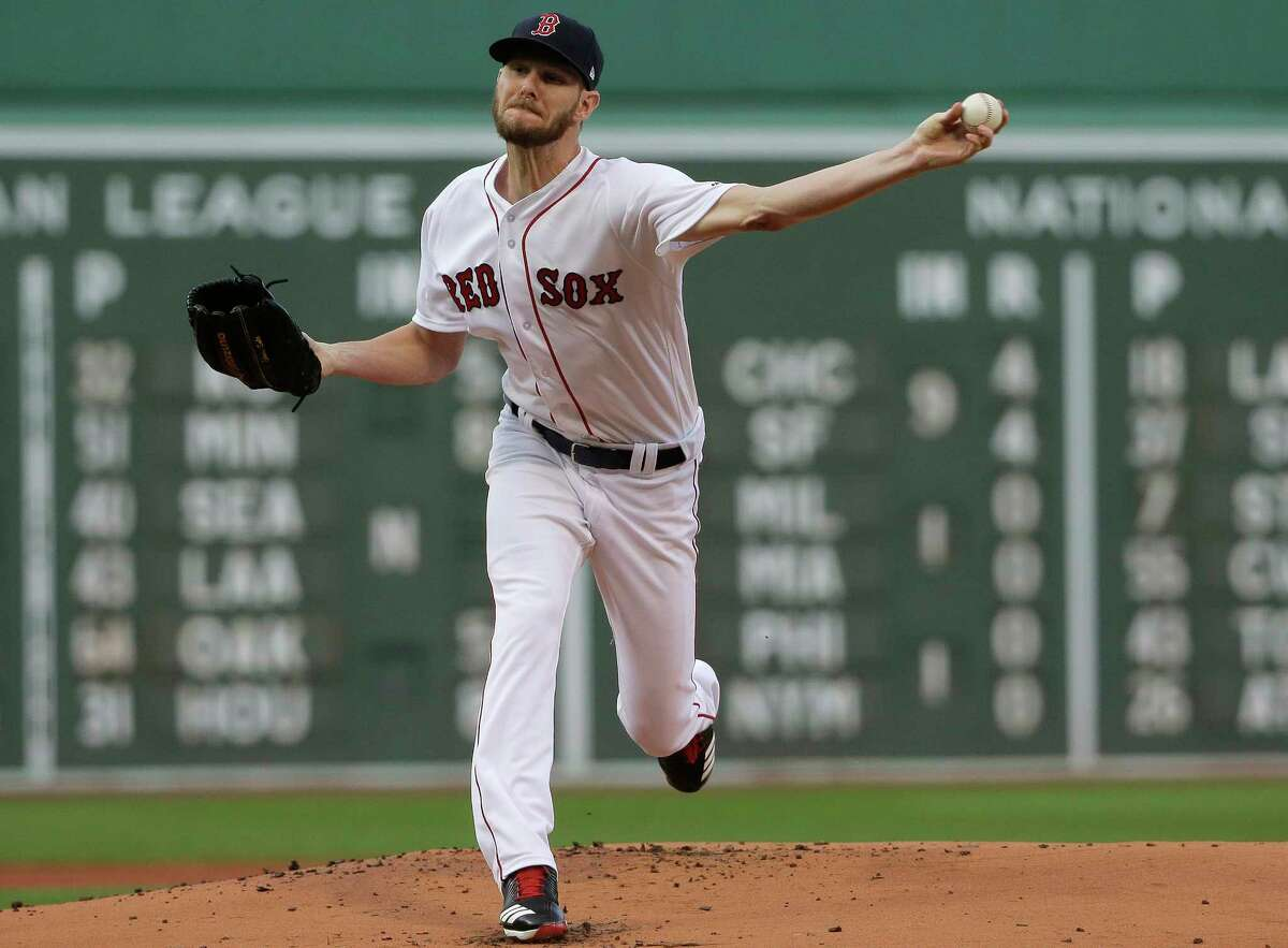 Boston Red Sox starting pitcher Chris Sale delivers during the first inning of the team's baseball game against the Texas Rangers, Wednesday, July 11, 2018, in Boston. (AP Photo/Steven Senne)
