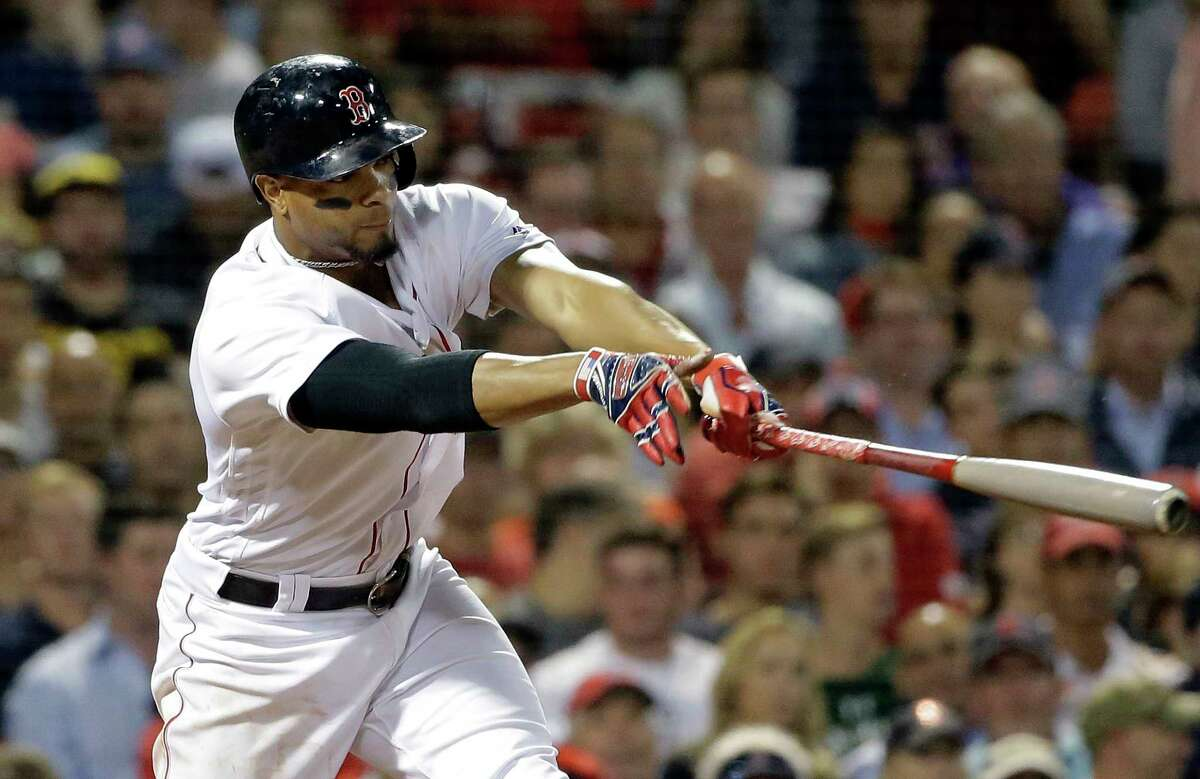 Boston Red Sox's Xander Bogaerts hits an RBI triple off Texas Rangers' Bartolo Colon during the fifth inning of a baseball game Wednesday, July 11, 2018, in Boston. (AP Photo/Steven Senne)