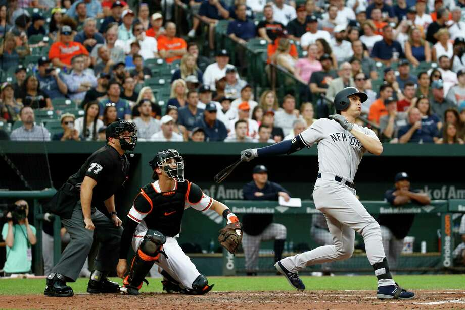 New York Yankees' Greg Bird, right, watches his grand slam in front of Baltimore Orioles catcher Caleb Joseph and home plate umpire Jim Reynolds during the third inning of a baseball game Wednesday, July 11, 2018, in Baltimore. (AP Photo/Patrick Semansky) Photo: Patrick Semansky / Copyright 2018 The Associated Press. All rights reserved.