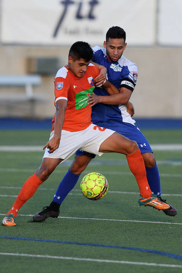 Sockers FC's Camilo Galindo (11) goes after the ball against Dutch Lions FC's Angel Lopez (20) in the second round of the NPSL playoffs July 11, 2018, at Grande Communications Stadium. James Durbin/Reporter-Telegram Photo: James Durbin / ? 2018 Midland Reporter-Telegram. All Rights Reserved.